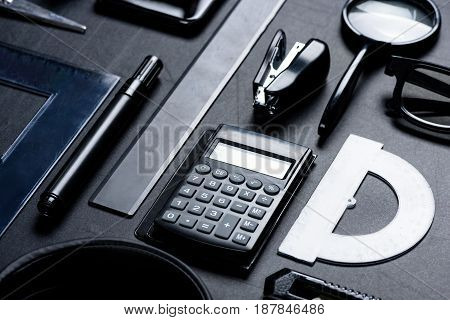 Calculator With Various Office Utensils Mock-up Isolated On Black
