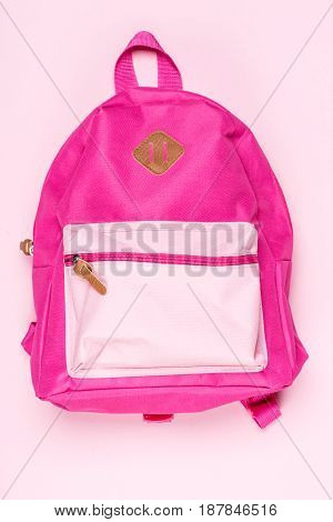 Close Up View Of Kid's Pink Schoolbag On Surface