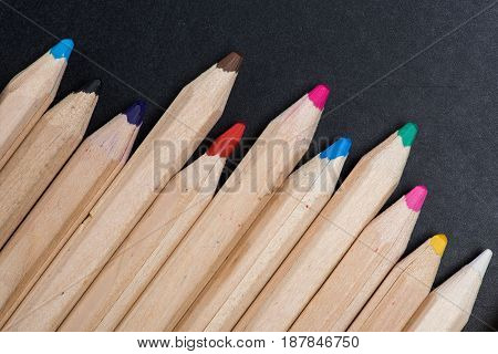 Close-up View Of Set Of Wooden Color Pencils On Black