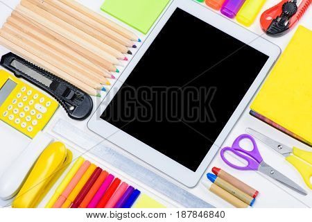 Top View Of Digital Tablet With Blank Screen And Colorful Office Supplies Isolated On White