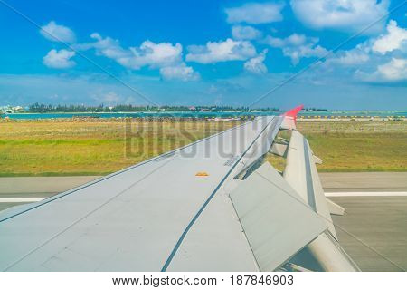 Airplane descending for landing to maldives island .