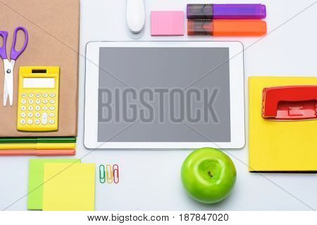 Top View Of Digital Tablet With Blank Screen And Colorful School Supplies Isolated On White