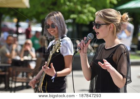 VILNIUS LITHUANIA - MAY 20: Unidentified young musician sings in Street Music Day on May 20 2017 in Vilnius. Its a most popular event on May in Vilnius Lithuania