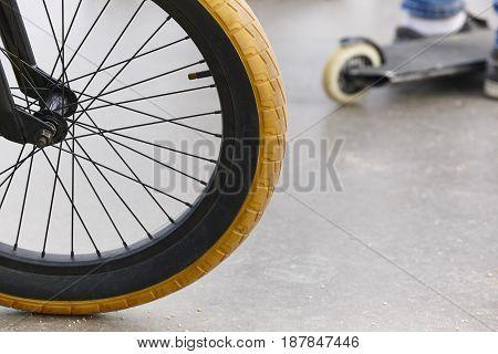 Bike wheel detail and skate. Sport background. Horizontal