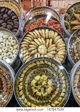 Assorted arabic sweet boxes on display in the bakery. An exotic variety of turkish delights, sweets and cookies.