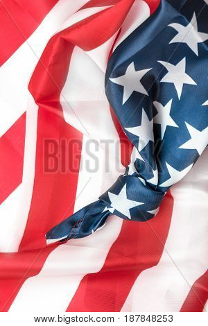Closeup of American flag with knot. Conceptual representation of an important event to remember. Save the date.