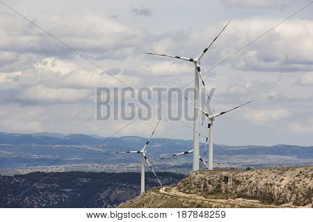 Wind mill farm in the countryside. Sustenaible energy production. Spain