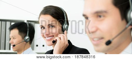 Young smiling beautiful business woman working in call center - panoramic banner