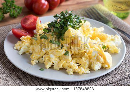 Scrambled Eggs With Fresh Microgreens On Top