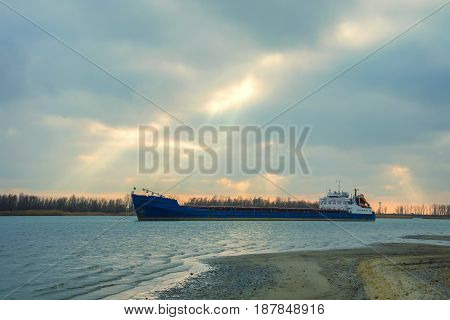 Cargo barge on river on warm day