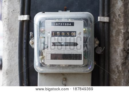 Kilowatt hour electricity meter power supply meter hour symbol and measuring dial install on pole