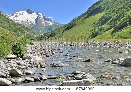 river in valley of glaciers in Savoie