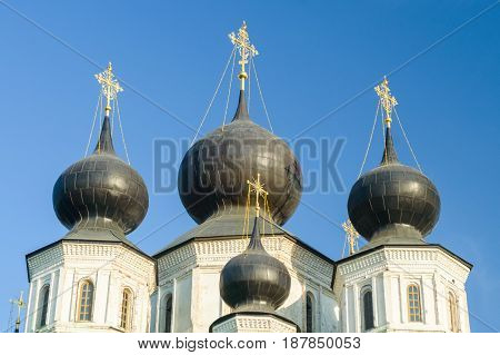 Russian Orthodox church with dark domes on sunny day