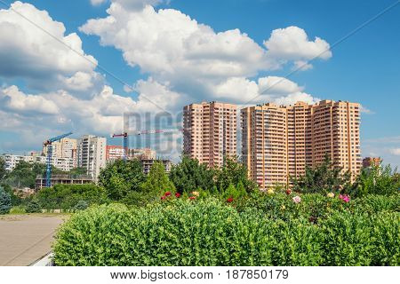 Blue sky and white clouds above buildings in modern city