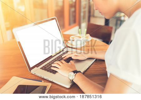 Female working on laptop in a cafe. woman using laptop in home. using laptop internet. hand using laptop in coffe shop. white screen. Business entrepreneur asian girl working online on laptop in cafe. business entrepreneur asian using laptop in home.