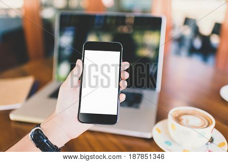 girl using smartphone in cafe. Hand holding smartphone white screen orange sunshine. smartphone vintage tone. smartphone black coler. woman using smartphone. using smartphone in coffee shop. using smartphone white screen. girl using smartphone.