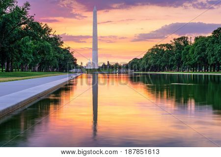 Washington Monument and Capitol Building from the Reflecting Pool in Washingon DC, USA.
