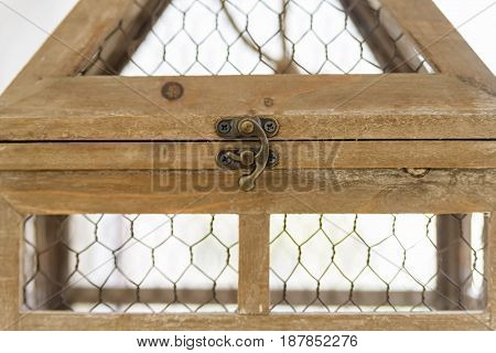 Closeup empty wooden birdcage used for interior decoration