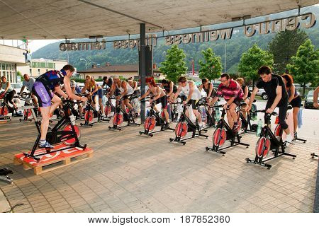 People Pedaling During A Spinning Class