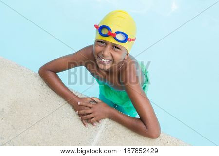 Portrait of little boy smiling in the pool