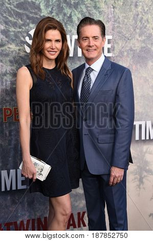LOS ANGELES - MAY 19:  Kyle MacLachlan and Desiree Gruber arrives for the premiere of