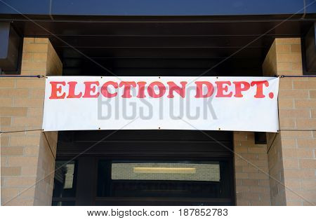 Banner hangs above entrance of an Election Department