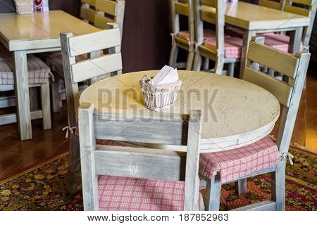 Interior of restaurant with wooden chairs and wooden table