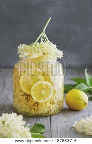 Homemade Elderflower Syrup. Elderflower syrup being made with lemon slices.