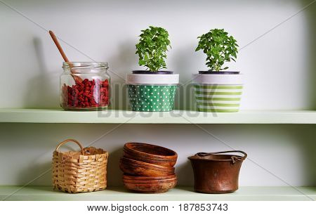 Kitchen shelf arrangement. Variety of bowls on shelf.