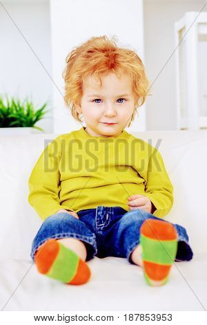 Happy 3 year old boy is playing at home. Child concept.