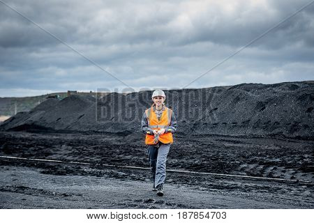 coal mining worker walking through open pit