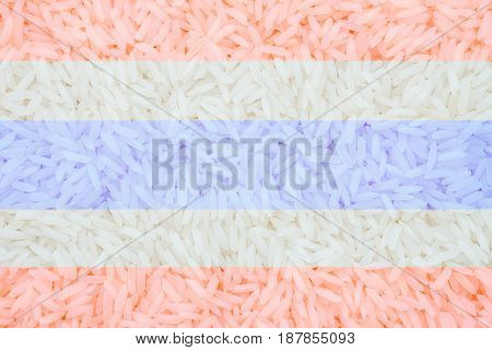 Closeup pile of white rice called jasmine rice signature of thailand with thailand flag sign textured background