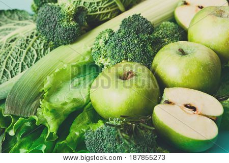 Green vegetables and fruits closeup. Diet, detox and healthy food concept. Ingredients for salad, greenery only