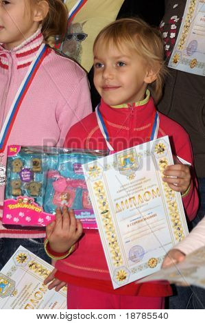 """RUSSIA, MOSCOW - DEC 12: Rewarding of winners of competition """"City youthful competitions on climbing sport Winter 2010"""" December 12, 2010 in Moscow, Russia"""