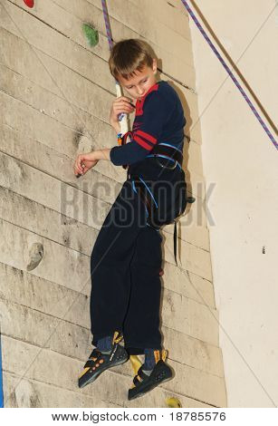 """RUSSIA, MOSCOW - DEC 12: Unidentified boy climbing on a wall """"City youthful competitions on climbing sport Winter 2010"""" December 12, 2010 in Moscow, Russia"""