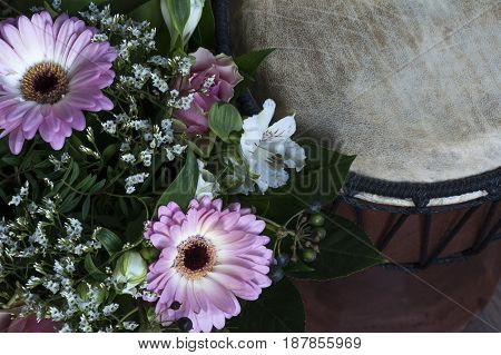One bouquet with pink gerberas and white flowers near the tambour