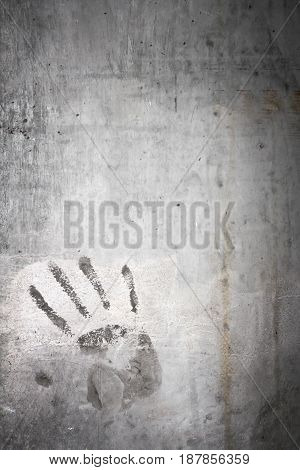 Grungy wall with hand print. It can be used as a backdrop grungy background or t-shirts and more. Fully editable.