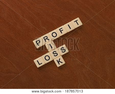 Crossword Puzzle With Words Risk, Profit And Loss. Risk Management Concept.