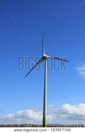 A Wind turbine generating electricity in a blue sky