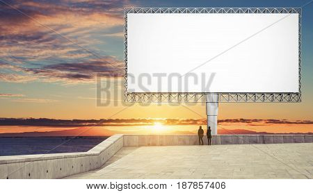Blank billboard for advertisement in summer sunset