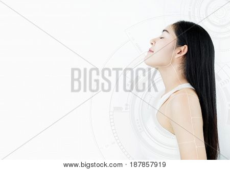 Beautiful Asian young woman, with technology interface graphic on white background. Beauty, cosmetic, treatment and surgery technology concepts