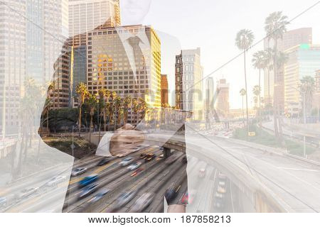 double exposure of businessman on busy road in modern city