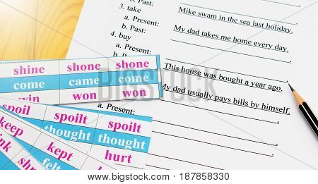 English test on table with pencil and cards