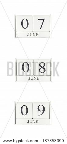 Closeup group of white wooden calendar with black 7 june 8 june 9 june word three date calendar isolated on white background