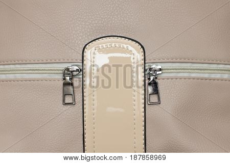 beige leather female bag texture close up