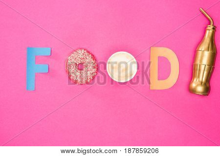 Top View Of Food Word Made From Donuts And Coffee Isolated On Pink. Junk Food Background