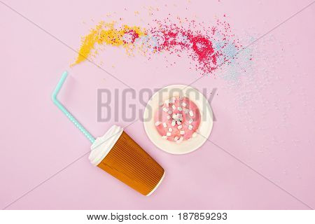 View From Above Of Coffee Cup And Donut With Raspberry Glaze On Pink. Donuts And Coffee Background