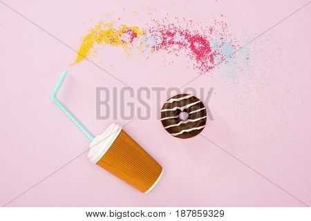 View From Above Of Cup Of Coffee And Donut With Chocolate Glaze On Pink. Donut Chocolate Background