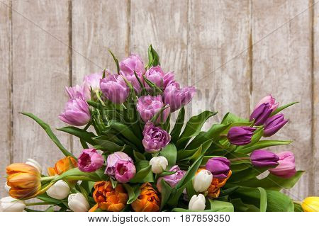 Frame of pink flower tulips. Floral background. Big spring bouquet on wooden backdrop with copyspace. Wedding, gift, birthday, 8 march, easter, mother's day greeting card concept