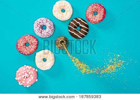 Overhead View Of Food Composition With Several Donuts With Various Glaze On Blue. Sweet Background O